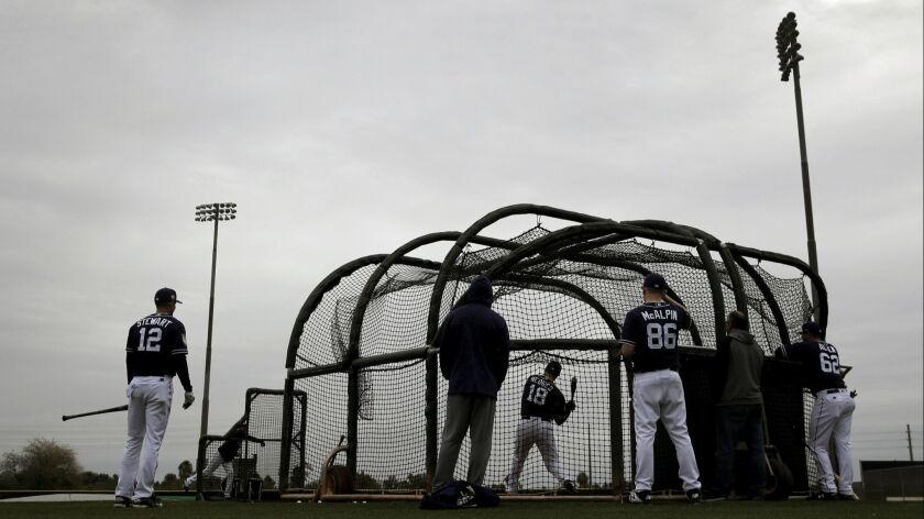 Padres catcher Austin Hedges takes batting practice Thursday. The team holds their first full-squad workout on Monday.