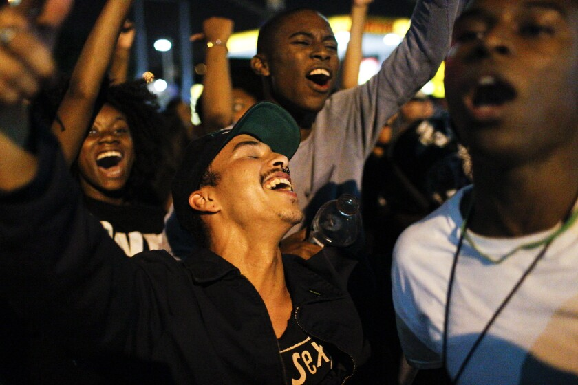 Protesters celebrate after shutting down the 405 Freeway during a Black Lives Matter protest in Inglewood.