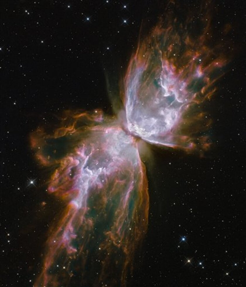 """In this film publicity image released by Warner Bros. Pictures, an image of a dying star forming the delicate shape of a celestial butterfly, referred to as a Butterfly Nebula, is shown in the film """"Hubble 3D"""". (AP Photo/Warner Bros.)"""