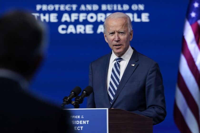 President-elect Joe Biden answers a reporter's question at The Queen theater, Tuesday, Nov. 10, 2020, in Wilmington, Del. (AP Photo/Carolyn Kaster)