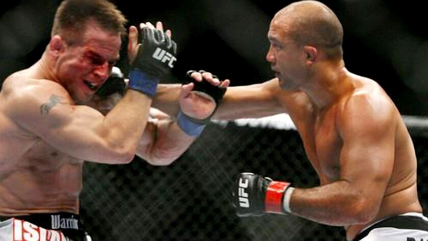 B.J. Penn lands a shot to Sean Sherk in the second round during their lightweight title fight at UFC 84 in Las Vegas.
