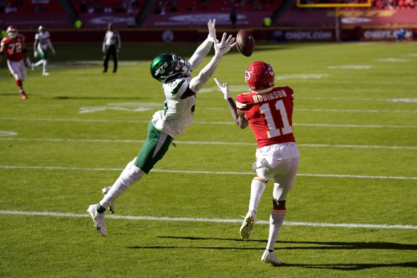 New York Jets cornerback Bless Austin, left, is unable to stop a touchdown catch made by Kansas City Chiefs wide receiver Demarcus Robinson (11) in the second half of an NFL football game on Sunday, Nov. 1, 2020, in Kansas City, Mo. (AP Photo/Jeff Roberson)