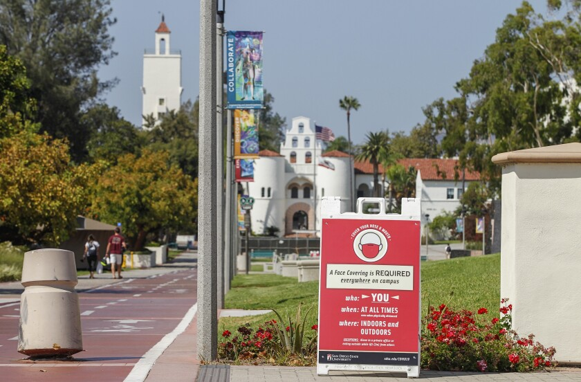A sign on the campus of San Diego State University promotes mask wearing on Wednesday, Sept. 2, 2020.