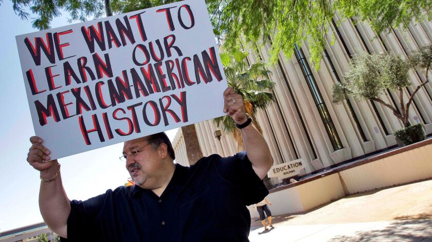 FILE - In this May 9, 2011 file photo, Carlos Galindo protests outside the Arizona Department of Edu