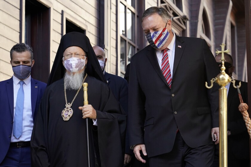 Secretary of State Mike Pompeo, right, speaks with Ecumenical Patriarch Bartholomew I, the spiritual leader of the world's Orthodox Christians, before departing the Patriarchal Church of St. George in Istanbul, Tuesday, Nov. 17, 2020. Pompeo's stop in Turkey is focused on promoting religious freedom and fighting religious persecution, which is a key priority for the U.S. administration, officials said. (AP Photo/Patrick Semansky, Pool)
