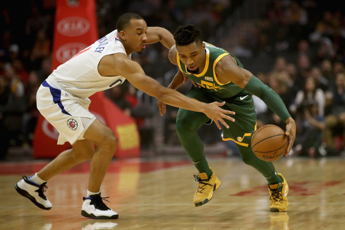 LOS ANGELES, CA - JANUARY 16: Avery Bradley #11 of the Los Angeles Clippers defends agains the dribble of Donovan Mitchell #45 of the Utah Jazz during the first half of a game at Staples Center on January 16, 2019 in Los Angeles, California. NOTE TO USER: User expressly acknowledges and agrees that, by downloading and or using this photograph, User is consenting to the terms and conditions of the Getty Images License Agreement. (Photo by Sean M. Haffey/Getty Images) ** OUTS - ELSENT, FPG, CM - OUTS * NM, PH, VA if sourced by CT, LA or MoD **
