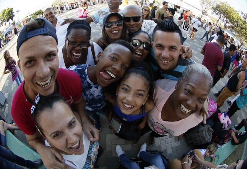 Cuban migrants stuck in Costa Rica pose for a group photo as they leave their camp at the airport.