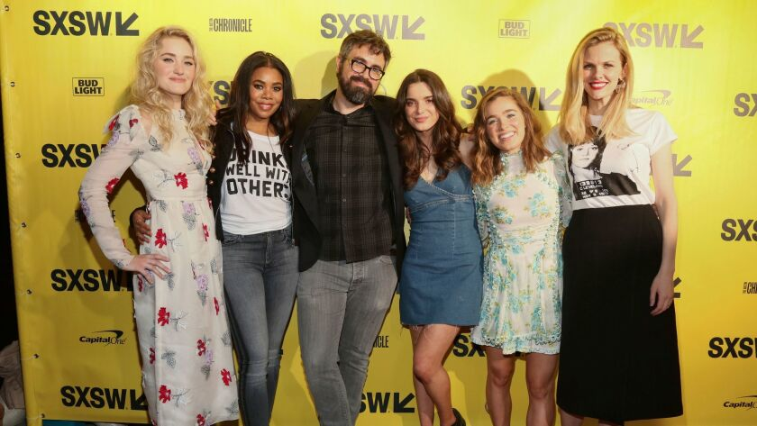 """AJ Michalka, from left, Regina Hall, director Andrew Bujalski, Dylan Gelula, Haley Lu Richardson and Brooklyn Decker, arrive for the world premiere of """"Support the Girls"""" during the South by Southwest Film Festival at the Zach Theatre Friday in Austin, Texas."""