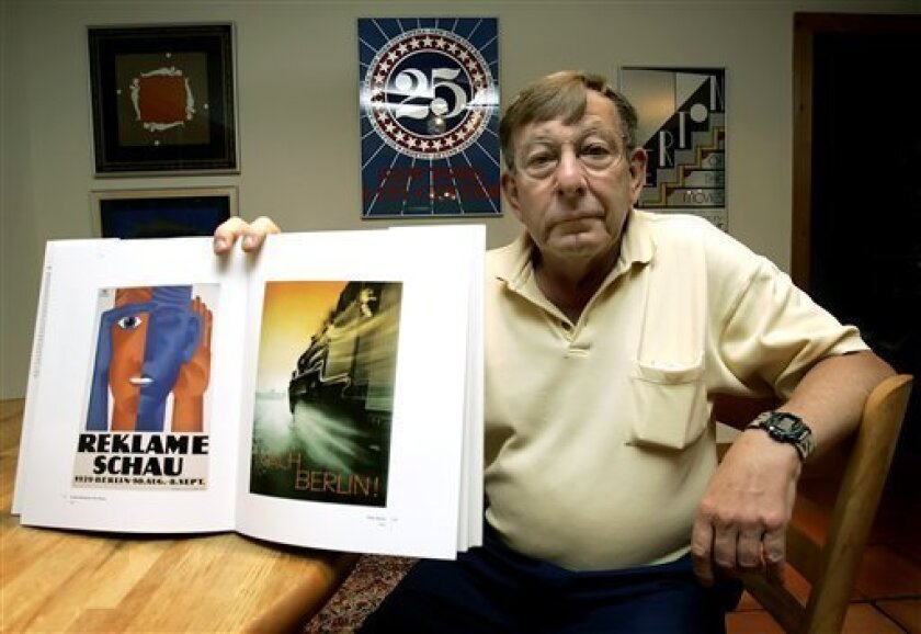 In this May 16 2006 file picture, Peter Sachs holds up a book with some of his father Hans Sachs' favorite posters at his home in Sarasota, Fla. A Berlin court has ruled Tuesday Feb. 10, 2009, that Hans Sachs never lost legal ownership to his poster collection when the Gestapo seized it. Sachs' son, Peter, a 71-year-old resident of Sarasota, Florida, is trying to reclaim 4,000 of his father's posters from the German Historical Museum in Berlin. The posters are worth around 4.5 million euros ( US dlrs 5.8 million). (AP Photo/Chris O'Meara)