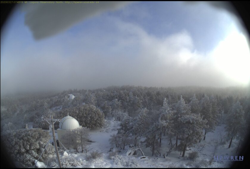 Snowfall across Palomar Mountain as seen early Friday from a research camera operated by UC San Diego, Scripps Institution of Oceanography and San Diego Supercomputer Center.