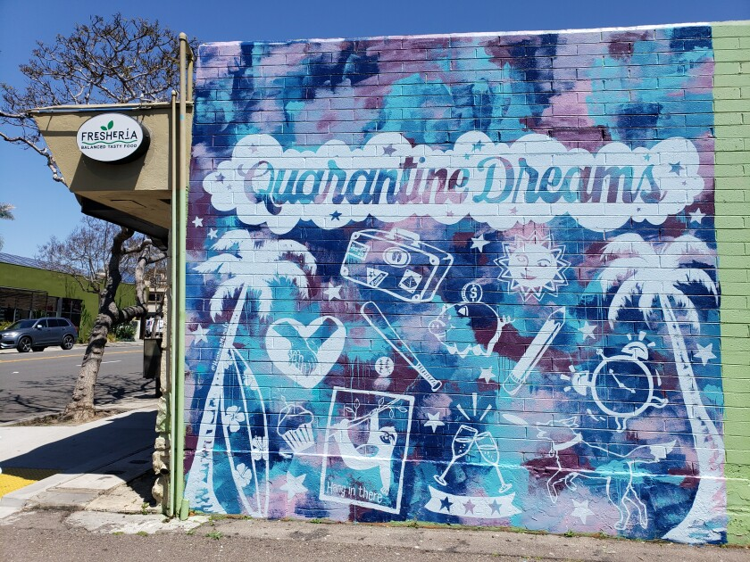 """Artist Hanna Daly's new mural, """"Quarantine Dreams"""" at 627 Pearl St., shows a surfboard, baseball, suitcase and images of other currently off-limit activities."""