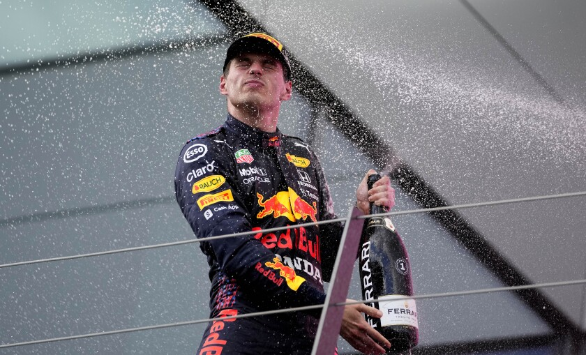 Red Bull driver Max Verstappen of the Netherlands sprays champagne after winning the Styrian Formula One Grand Prix at the Red Bull Ring racetrack in Spielberg, Austria, Sunday, June 27, 2021. (AP Photo/Darko Vojinovic)
