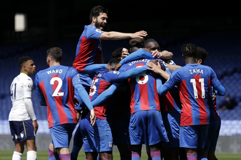 Crystal Palace's Tyrick Mitchell,obscured, is congratulated by teammates after scoring his team's third goal during the English Premier League soccer match between Crystal Palace and Aston Villa at Selhurst Park in London, Sunday, May 16, 2021. (AP Photo/Henry Browne/Pool)