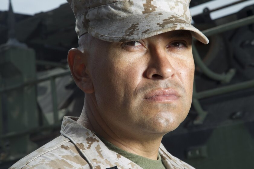 Staff Sgt. Javier Acosta along with another Marine, Sgt. Ronny Pool used their life-saving training to help a victim of a motorcycle accident.