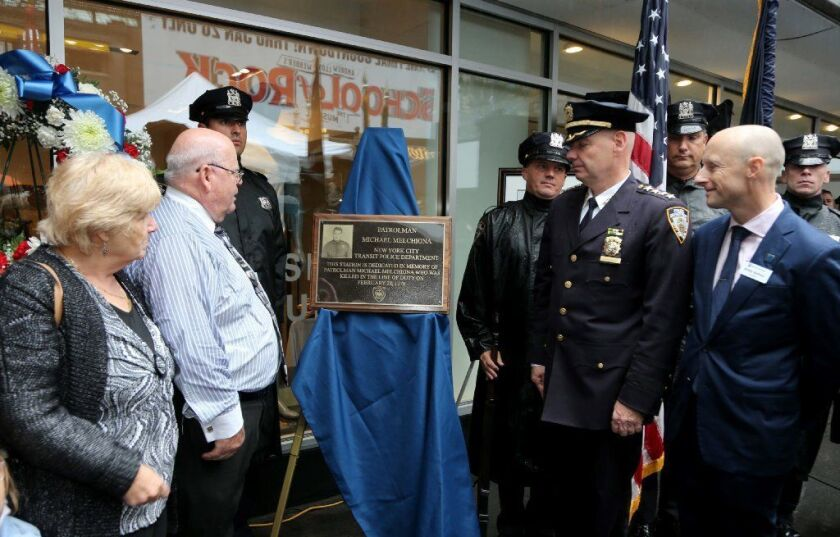 (L-R) Anne Barletta, her brother Hank Melchiona, NYPD Chief Departmanet Terance Monahan and MTA President Andy Byford unveil a plaque at the 50th St. and Broadway subway station in honor of Transit Police Officer Michael Melchiona.