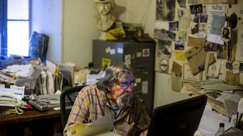 DOWNIEVILLE, CALIF. - DECEMBER 13: Don Russell works in the Mountain Messenger newsroom on Thursday,