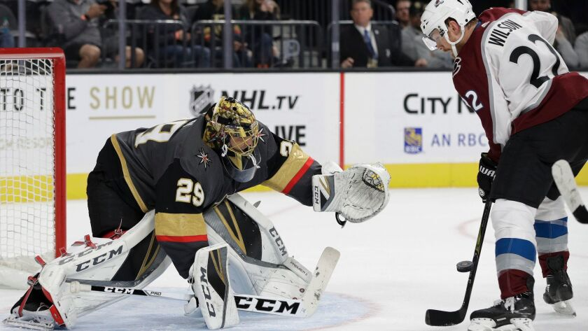 Vegas Golden Knights goalie Marc-Andre Fleury blocks a shot in front of Colorado Avalanche's Colin W