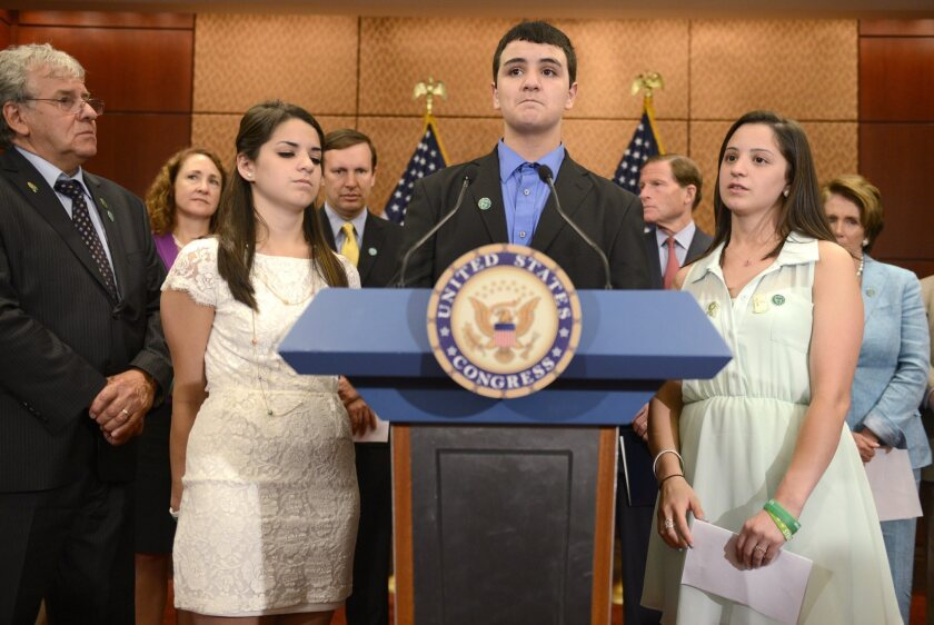 In the six months since the tragedy at Sandy Hook Elementary School in Newtown, Conn., six states have strengthened firearms laws and in New Jersey and California, pending legislation seeks to tighten the regulation of assault weapons. Above: Carlos Soto, center, with his sisters Carley, left, and Jillian, right, visited Capitol Hill in Washington, D.C., to remember their slain sister Victoria Soto who was a teacher at Sandy Hook.