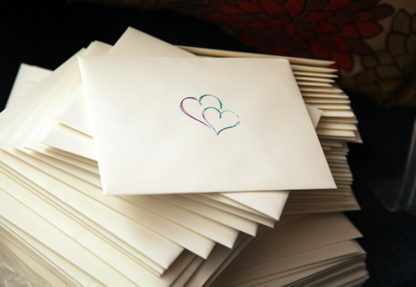 Wedding cards for the wedding of Ortiz and Aiyanna were stacked in their home.