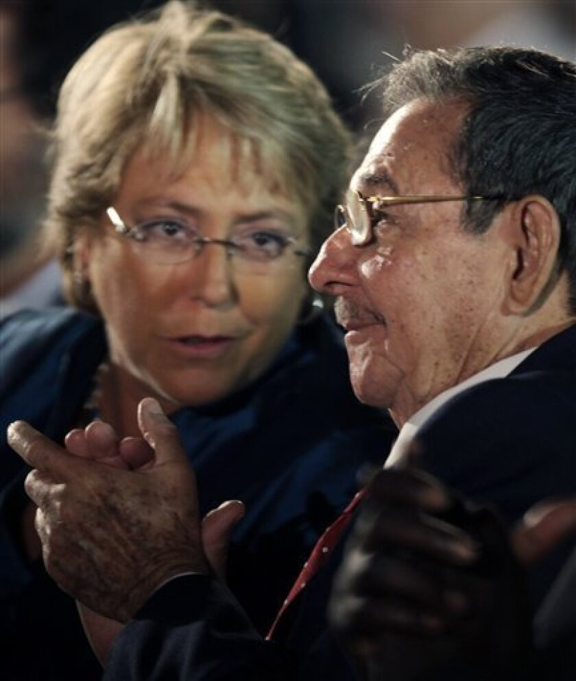 """Cuba's President Raul Castro, right, and Chile's President Michelle Bachelet attend the opening ceremony of the International Book Fair in Havana, Thursday, Feb. 12, 2009. Bachelet said she met with Fidel Castro for 90 minutes, and the ailing Cuban leader appeared """"in very good shape"""". (AP Photo/Javier Galeano)"""