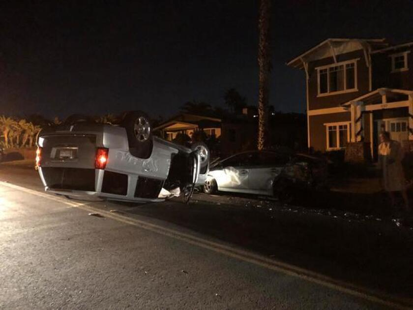 The accident at 537 Nautilus St. in La Jolla on Dec. 3, 2018 marks the second time this year, a car has flipped outside this home after sideswiping parked cars.