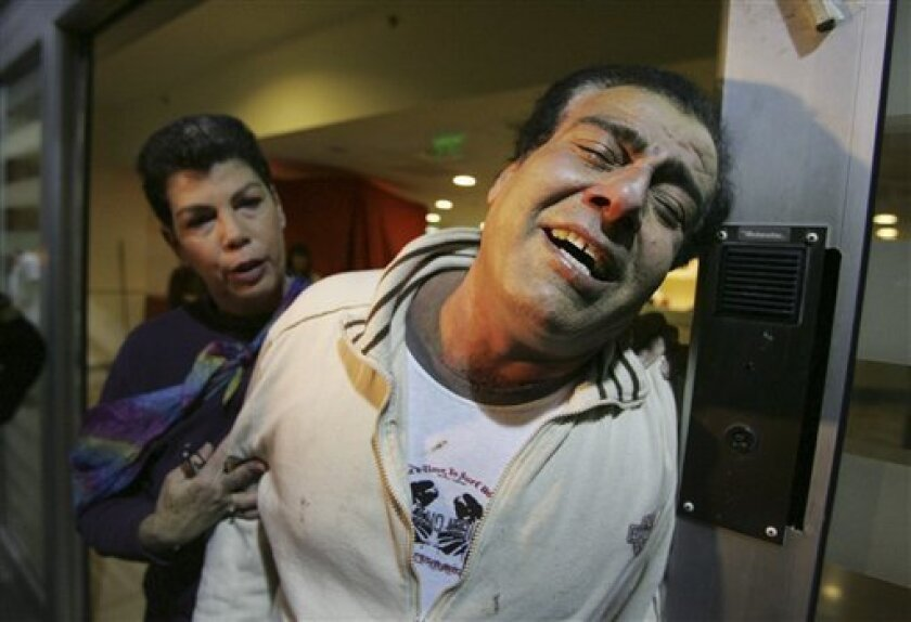 Dr. Ezzeldeen Abu Al-Aish, a Palestinian doctor who trained in Israel, bursts into tears as he is brought in Tel Hashomer hospital in Tel Aviv, Israel, after he was evacuated from from Gaza Strip, late Friday Jan. 16, 2009. Abu Al-Aish, has been a regular fixture on Israeli television during the