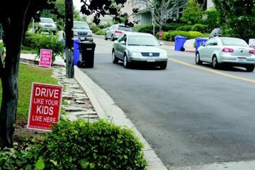 Signs on Muirlands Drive caution speeders to slow down. Photo: Dave Schwab