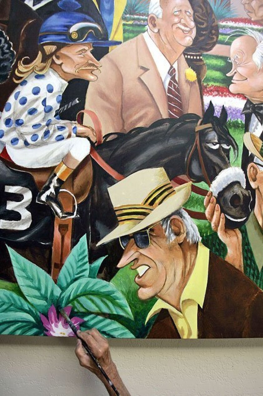 Pierre Bellocq touched up his mural at the Del Mar Racetrack, which includes (clockwise from left) jockey Jerry Lambert on Native Diver, Clement Hirsch, Bob Hope and W.L. Proctor. (John Gastaldo / Union-Tribune)