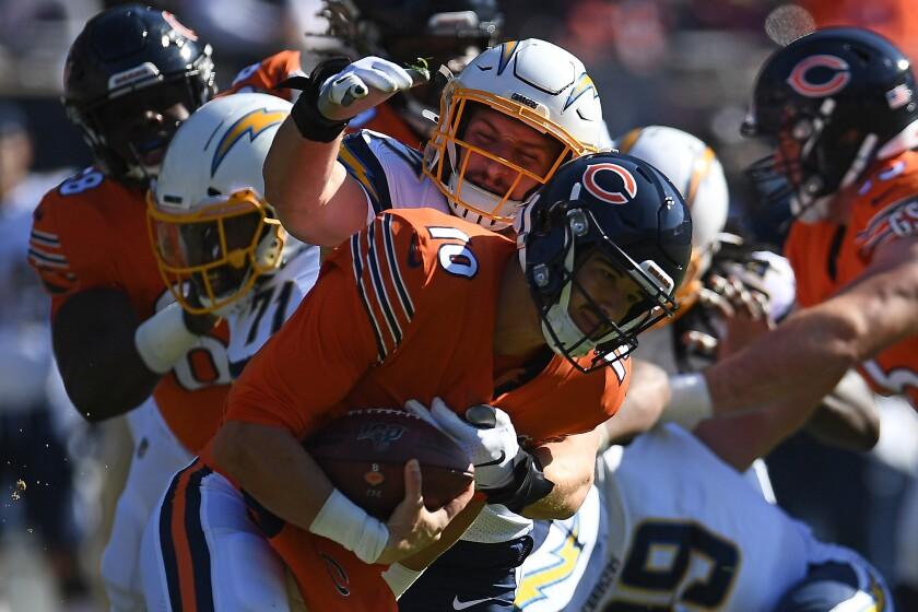 The Chargers' Joey Bosa records one of his two sacks on Bears quarterback Mitch Trubisky.