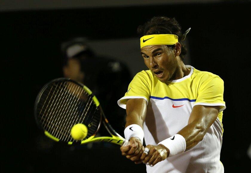 Rafael Nadal of Spain, returns the ball to Pablo Carreno of Spain, at the Rio Open tennis tournament, in Rio de Janeiro, Brazil, Tuesday, Feb. 16, 2016. (AP Photo/Silvia Izquierdo)