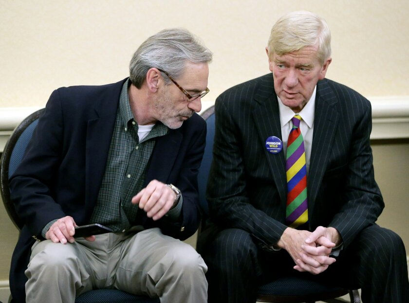 Libertarian vice presidential candidate Bill Webb, right, chats with Joe Hunter, communications director for the Gary Johnson campaign, at the National Libertarian Party Convention, Friday, May 27, 2016, in Orlando, Fla. (AP Photo/John Raoux)