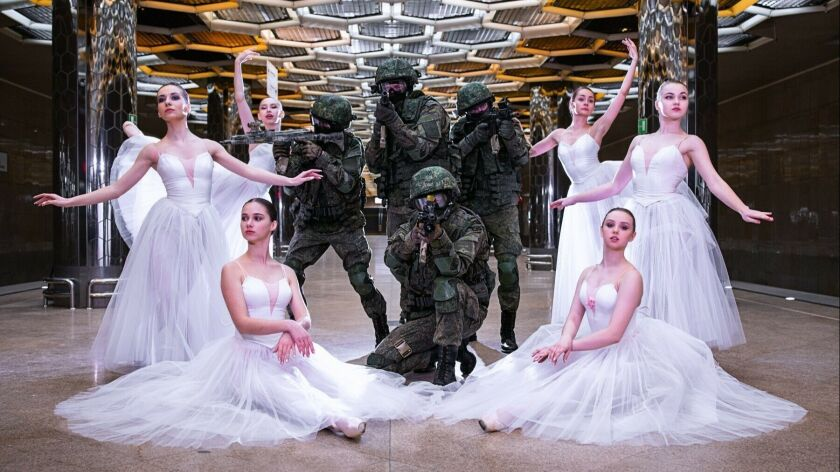 In this undated photo provided by Russian Defense Ministry Press Service, soldiers and ballerinas po