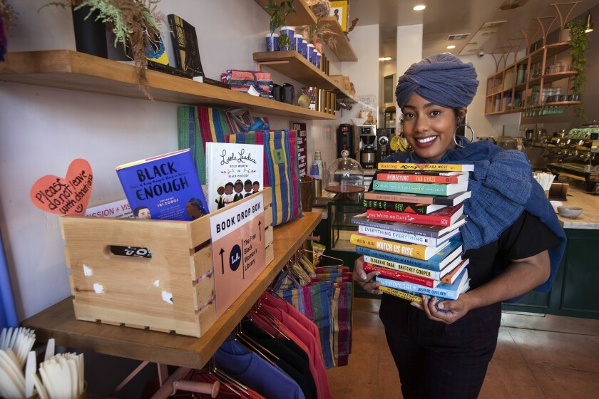 Asha Grant, founder of the L.A. chapter of the Free Black Women's Library, at a lending library inside Bloom and Plume, a black-owned coffee shop on Temple Street.