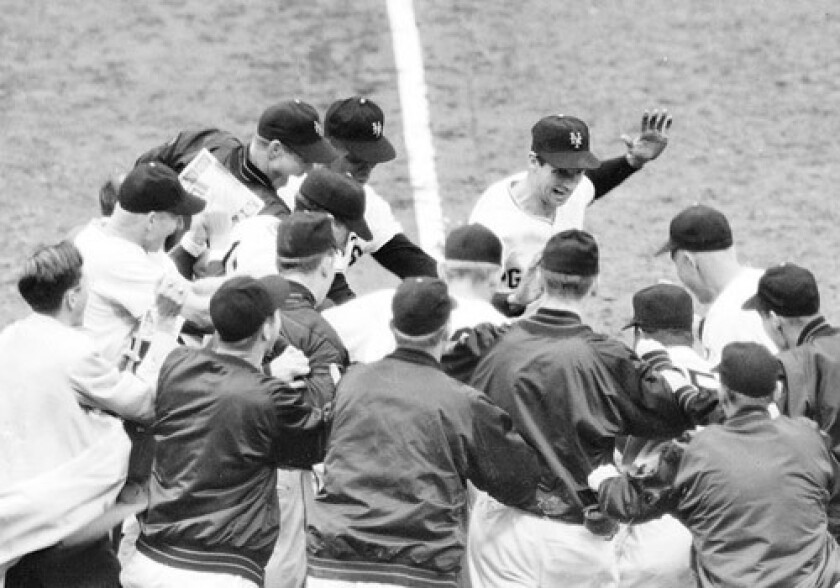 Bobby Thomson celebrates with his New York Giants teammates.