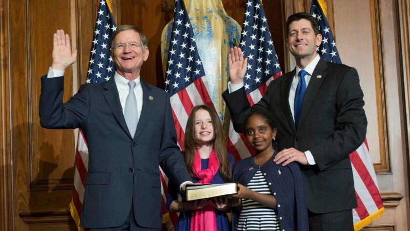 Rep. Lamar Smith (R-Texas), left, is sworn in to his new term by House Speaker Paul Ryan in January. Oil and gas contributors have directed nearly $700,000 in Smith's direction since he entered in Congress in 1987.