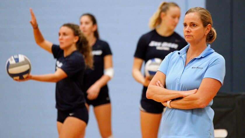 SAN DIEGO, November 14, 2017 | USD women's volleyball coach Jennifer Petrie, right, watches her play