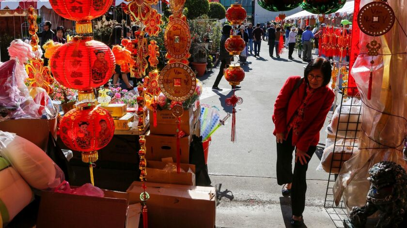 At the Flower Festival in front of the Asian Garden Mall in Westminster, vendors are selling their new year's decorations, flowers and traditional souvenirs.