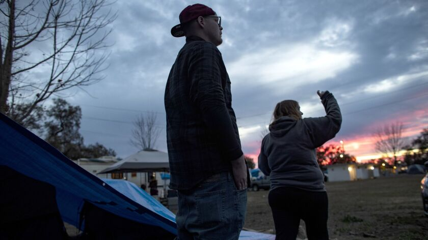 GRIDLEY, CA - NOVEMBER 26, 2018: Camp fire evacuees Nathan and Suzie Thomas of Paradise keep an eye