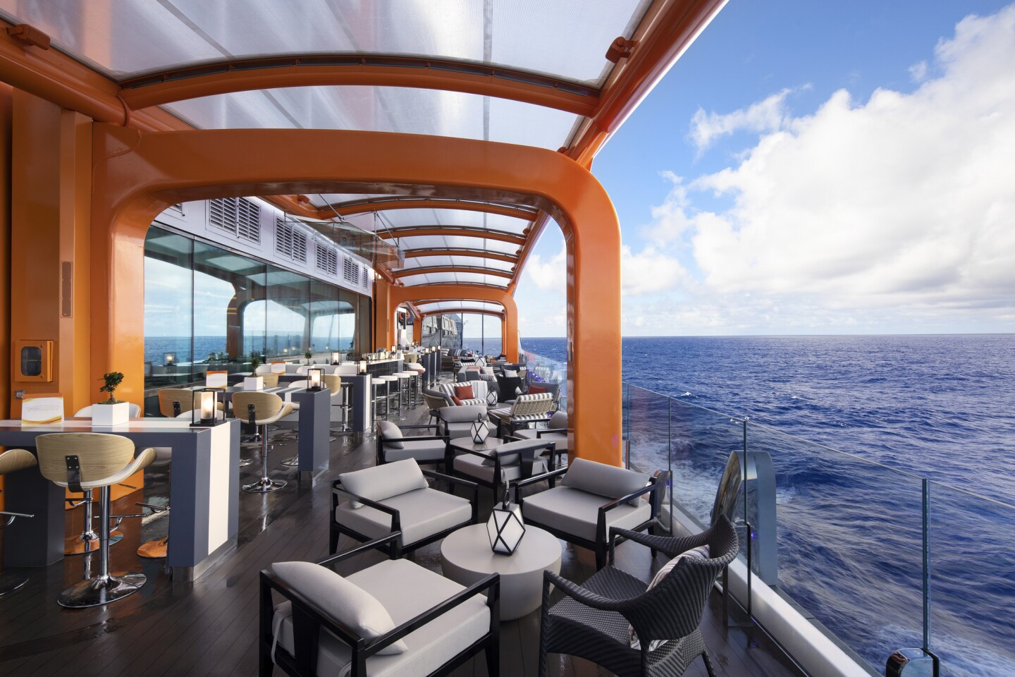 One of Celebrity Edge's most talked about innovations is the tangerine-colored Magic Carpet on the starboard side that can be lowered to Deck 2 -- for use with tenders to shore or raised as high as Deck 16, where it becomes a lounge.