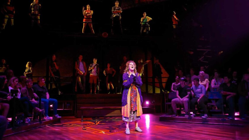 """The audience gets into the act with Emily Lopez, center, and the ensemble in """"Carrie: The Musical"""" at the Los Angeles Theatre."""