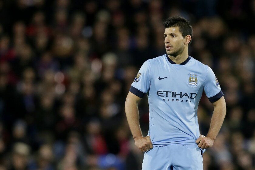 Manchester City's Sergio Aguero looks on during the English Premier League soccer match between Crystal Palace and Manchester City at Selhurst Park Stadium, London, Monday, April 6, 2015. (AP Photo/Tim Ireland)