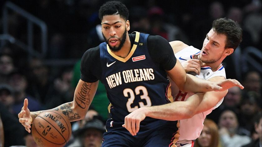 Clippers' Danilo Gallinari hounds Pelicans' Anthony Davis in the first quarter at the Staples Center.