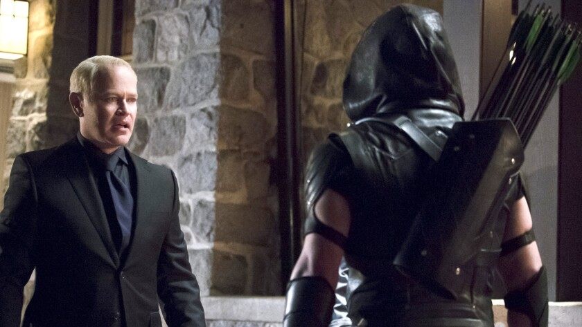 "Neal McDonough, left, and Stephen Amell in ""Arrow"" on the CW."
