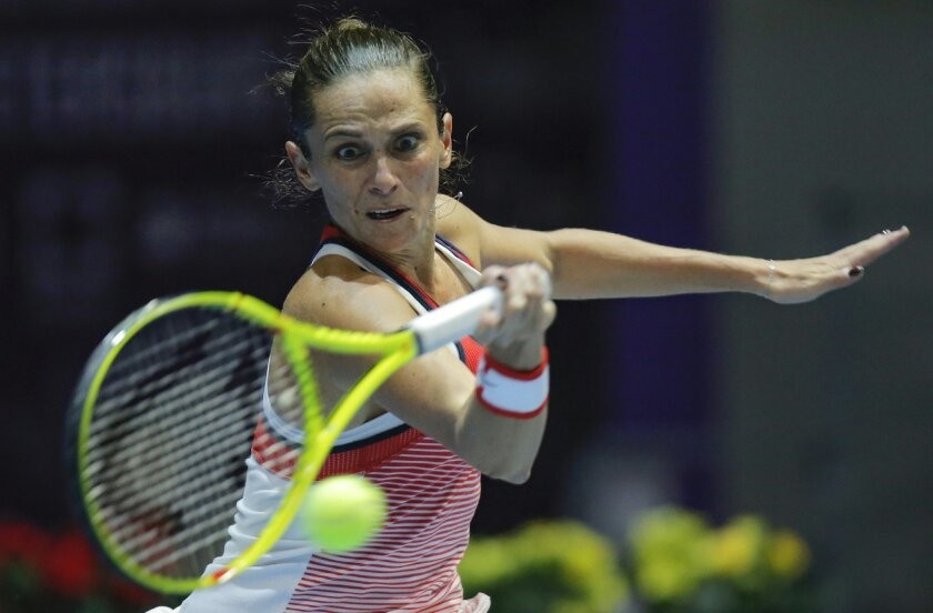 Roberta Vinci of Italy returns the ball to Timea Babos of Hungary during the St. Petersburg Ladies Trophy-2016 tennis tournament match in St. Petersburg, Russia, Friday, Feb. 12, 2016. (AP Photo/Dmitri Lovetsky)