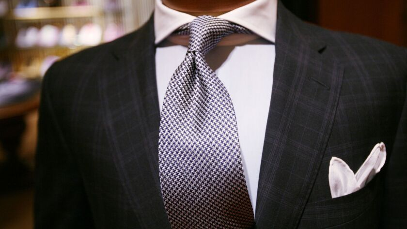 An Italian-made suit is displayed at Paul Stuart clothing store on Monday, July 28, 2008 in New York