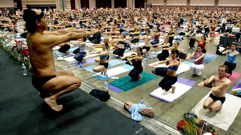 Bikram Choudhury, front, founder of the Yoga College of India and creator and producer of Yoga Expo 2003, leads a yoga class at the Expo at the Los Angeles Convention Center.