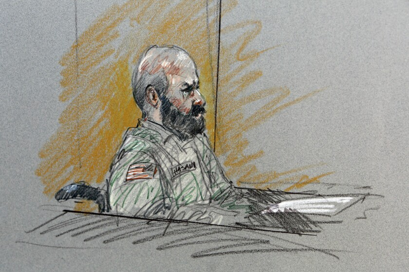 A drawing shows Maj. Nidal Malik Hasan sitting in court during his court-martial in Fort Hood, Texas.