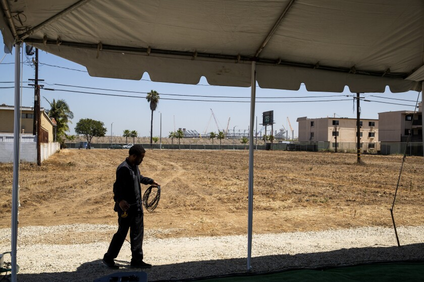 The dirt lot shown is where the proposed Clippers arena would be located in Inglewood.