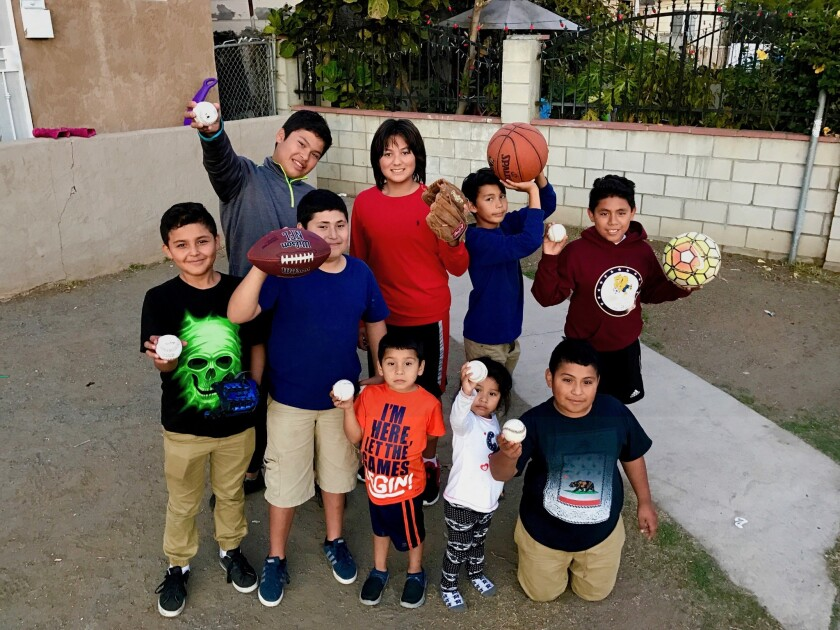 Danny Limas An (center in a red shirt) with some of the kids in Mexico who happily received his sports gear donations this holiday season.