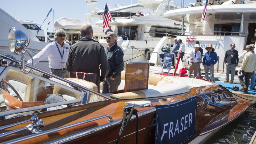 From left, Neal Esterly describes the features of a J Craft boat to Robert Brown and Chris Fletcher